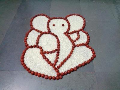 Ganesha rangoli with rice & betel nut .ganpati rangoli.ganesh muggulu.ganesha kolam